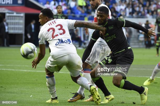 Lyon's Dutch defender Kenny Tete vies with Guingamp's French defender Marcus Coco during the French L1 football match Lyon vs Guingamp , on September...