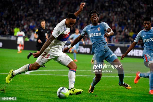Lyon's Dutch defender Kenny Tete vies with Monaco's Dutch defender Terence Kongolo during the French L1 football match Lyon vs Monaco on October 13...