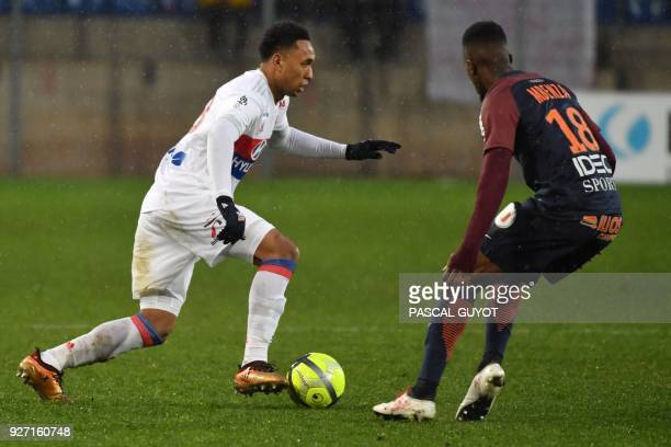 Lyon's Dutch defender Kenny Tete vies with Montpellier's French forward Isaac Mbenza during the French L1 football match between Montpellier and Lyon...