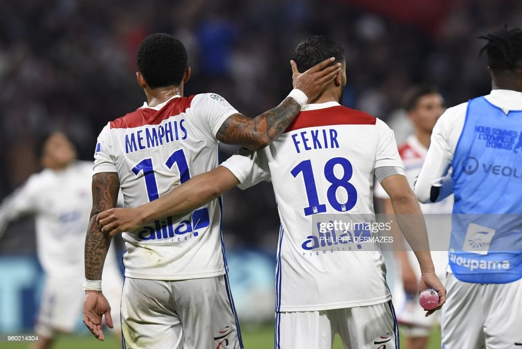 Lyon's Dutch forward Memphis Depay (L) and Lyon's French midfielder Nabil Fekir (R) celebrate their victory at the end of the French L1 football match between Olympique Lyonnais and OGC Nice, on May 19, 2018, at the Groupama Stadium in Decines-Charpieu near Lyon, central-eastern France.