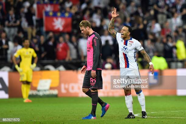 Lyon's Dutch forward Memphis Depay celebrates after scoring a goal as Toulouse's Swedish midfielder Ola Toivonen looks on during the French L1...