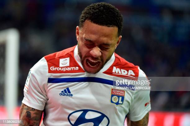 Lyon's Dutch forward Memphis Depay celebrates after scoring a goal during the French L1 football match between Lyon and Angers on April 19 at the...