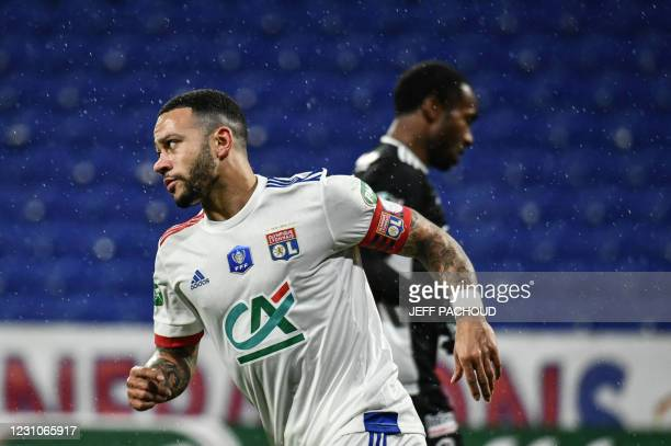 Lyon's Dutch forward Memphis Depay celebrates after scoring a goal during the French Cup football match, Olympique Lyonnais and AC Ajaccio on...