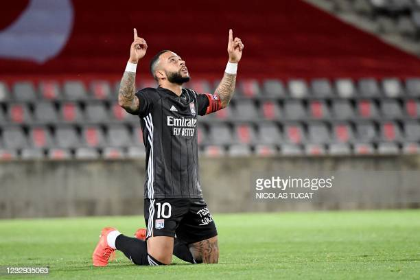 Lyon's Dutch forward Memphis Depay celebrates after scoring a goal during the French L1 football match between Nimes Olympique and Olympique Lyonnais...
