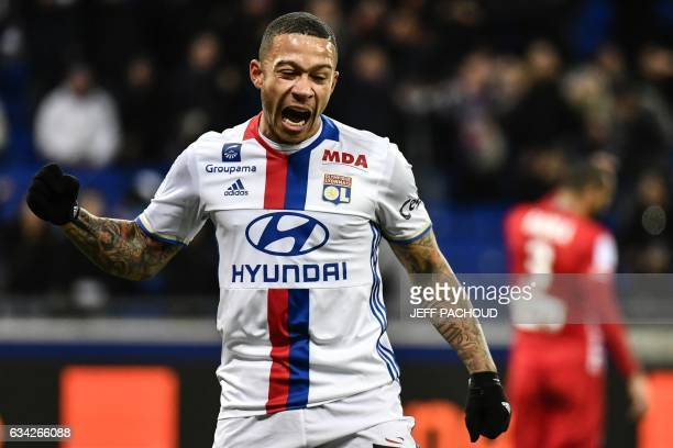 Lyon's Dutch forward Memphis Depay celebrates after scoring a goal during the French Ligue 1 football match between Olympique Lyonnais and Nancy on...