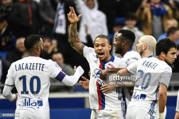 Lyon's Dutch forward Memphis Depay celebrates after scoring a goal during the French L1 football match Olympique Lyonnais vs FC Metz at Parc...