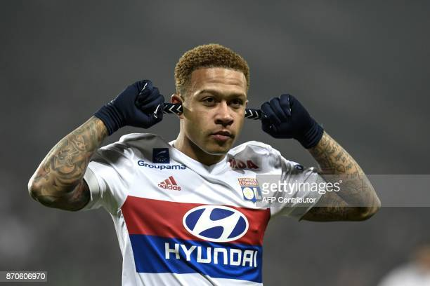 Lyon's Dutch forward Memphis Depay celebrates after scoring a goal during the L1 football match AS SaintEtienne vs Olympique Lyonnais on November 5...