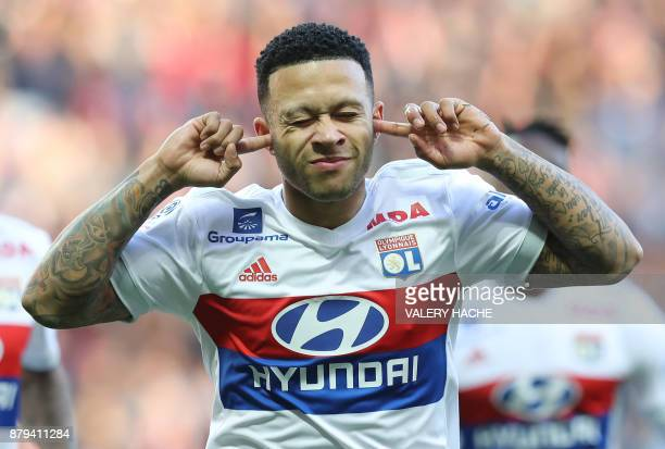 Lyon's Dutch forward Memphis Depay celebrates after scoring a goal during the French L1 football match Nice vs Lyon at The 'Allianz Riviera' Stadium...
