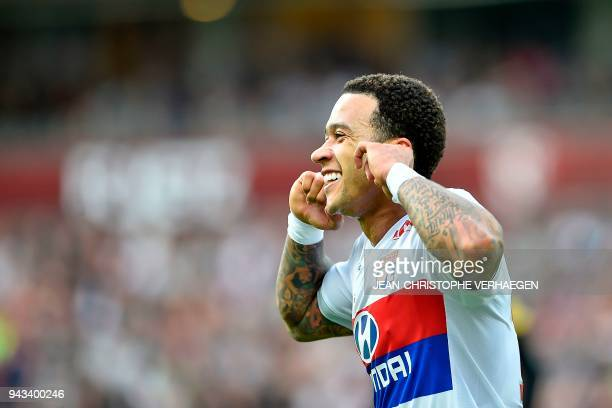 Lyon's Dutch forward Memphis Depay celebrates after scoring a goal during the French L1 football match between Metz and Lyon on April 8 2018 at Saint...