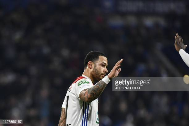 Lyon's Dutch forward Memphis Depay celebrates after scoring during the French Cup quarterfinal football match between Olympique Lyonnais and Stade...