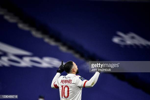 Lyon's Dutch forward Memphis Depay celebrates after scoring during the French L1 football match between Lyon and RC Lens at The Groupama Stadium at...
