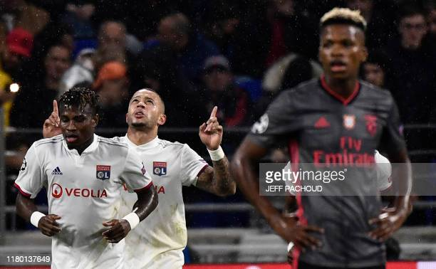 Lyon's Dutch forward Memphis Depay celebrates after scoring his team's second goal during the UEFA Champions League Group G football match between...
