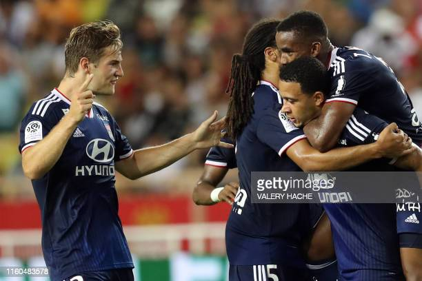 Lyon's Dutch forward Memphis Depay celebrates after scoring the 02 goal during the French L1 football match between AS Monaco and Olympique Lyonnais...