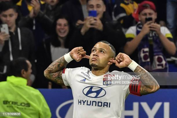 Lyon's Dutch forward Memphis Depay celebrates after scoring their first goal during the French L1 football match between Olympique Lyonnais and FC...