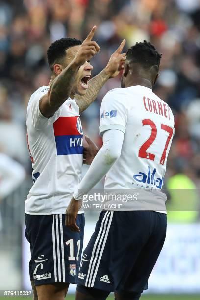 Lyon's Dutch forward Memphis Depay celebrates alongside teammate Lyon's French forward Maxwel Cornet after scoring during the French L1 football...