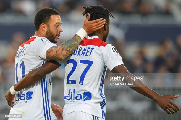 Lyon's Dutch forward Memphis Depay celebrates scoring a goal during the French L1 football match between Bordeaux and Lyon on April 26 2019 at the...