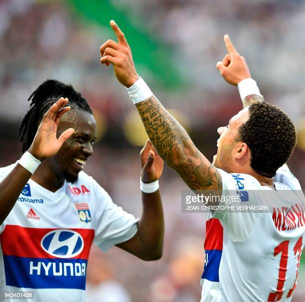 Lyon's Dutch forward Memphis Depay celebrates with Lyon's Burkinabe forward Bertrand Traore after scoring a goal during the French L1 football match...