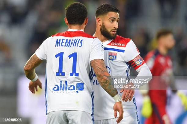 Lyon's Dutch forward Memphis Depay celebrates with Lyon's French midfielder Nabil Fekir after scoring a goal during the French L1 football match...