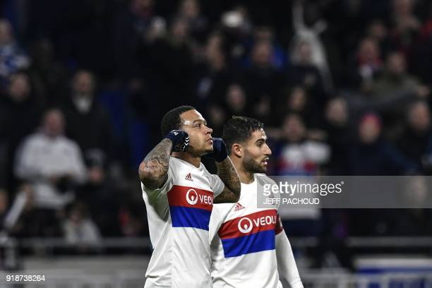 Lyon's Dutch forward Memphis Depay celebrates with Lyon's French midfielder Nabil Fekir after scoring a goalduring the Europa League football match...