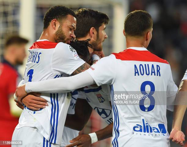 Lyon's Dutch forward Memphis Depay celebrates with teammates after scoring a goal during the French L1 football match between Bordeaux and Lyon on...