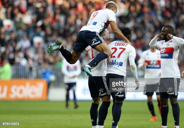 Lyon's Dutch forward Memphis Depay celebrates with teammates Lyon's Spanish forward Mariano Diaz and Lyon's French forward Maxwel Cornet after...