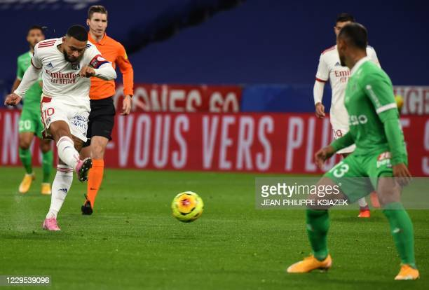 Lyon's Dutch forward Memphis Depay fights for the ball with SaintEtienne's Peruvian defender Miguel Trauco during the French L1 football match...