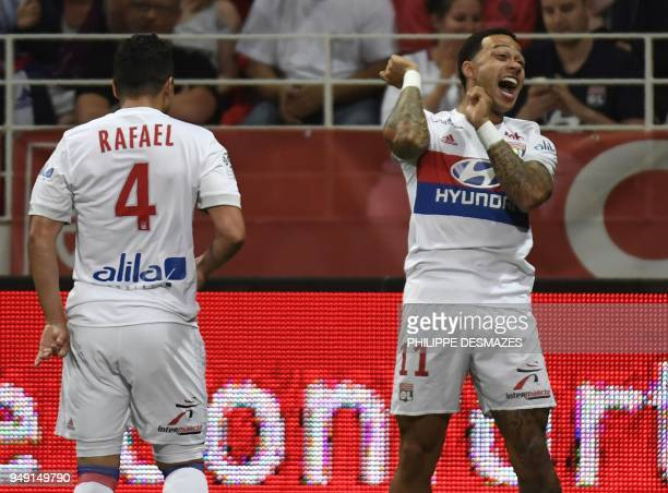 Lyon's Dutch forward Memphis Depay is congratuled by teamate 'Lyon's Brazilian defender Rafael da Silva after scoring during the French L1 football...