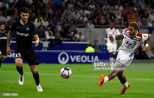 Lyon's Dutch forward Memphis Depay kicks the ball during the French L1 football match between Lyon and Marseille on September 23 2018 at the Groupama...