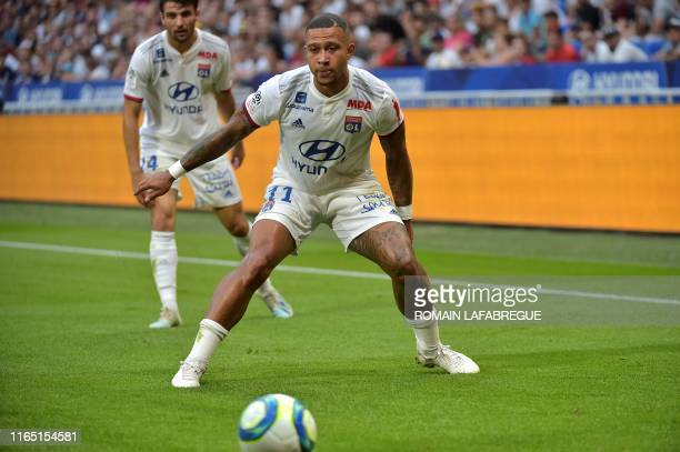 Lyon's Dutch forward Memphis Depay looks the ball during the French L1 football match between Lyon and Bordeaux on August 31 in Decines-Charpieu,...