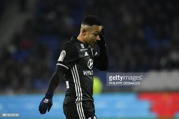 Lyon's Dutch forward Memphis Depay reacts after missing an opportunity to score during the French L1 football match between Olympique Lyonnais and...