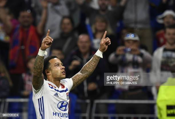 Lyon's Dutch forward Memphis Depay reacts after scoring during the French L1 football match between Olympique Lyonnais and OGC Nice on May 19 at the...