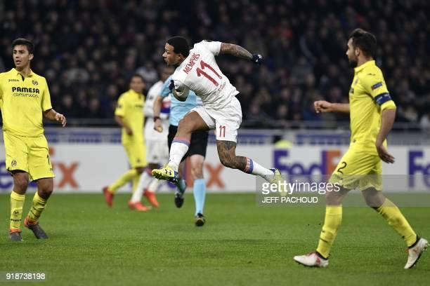 Lyon's Dutch forward Memphis Depay scores a goal during the Europa League football match Olympique Lyonnais vs Villarreal CF on February 15 at the...
