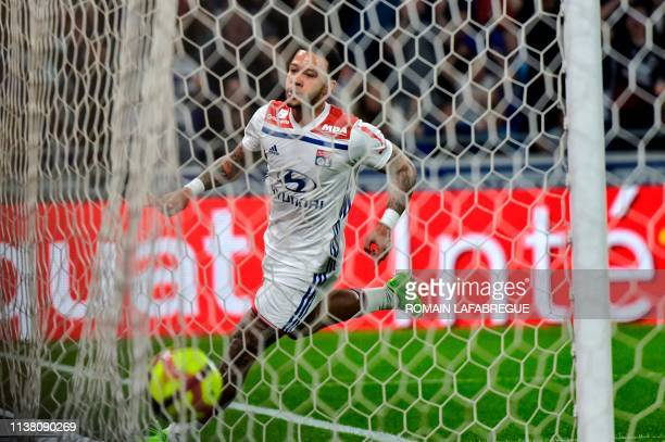 Lyon's Dutch forward Memphis Depay scores a goal during the French L1 football match between Lyon and Angers on April 19 at the Groupama Stadium in...