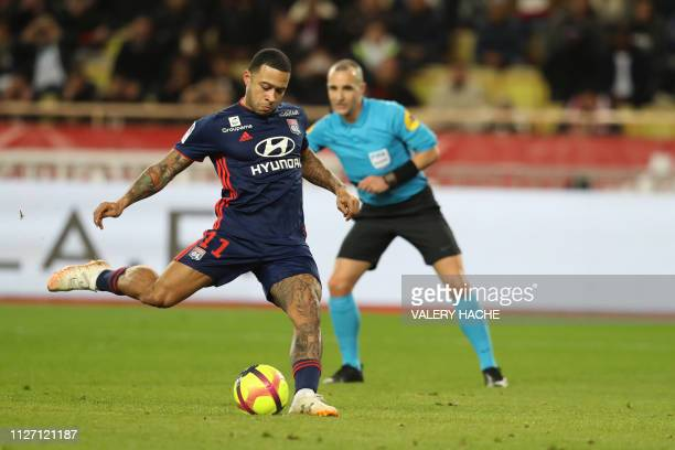 Lyon's Dutch forward Memphis Depay shoots a penalty during the French L1 football match Monaco vs Lyon on February 24 2019 at the Louis II Stadium in...