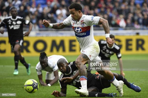 Lyon's Dutch forward Memphis Depay vies with Amiens' French defender Prince Gouano during the French L1 football match between Olympique Lyonnais and...