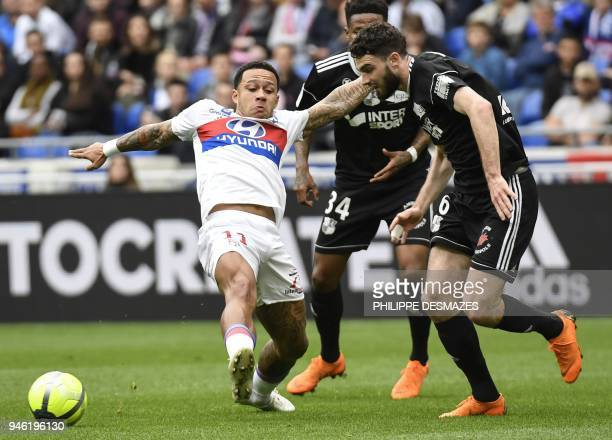 Lyon's Dutch forward Memphis Depay vies with Amiens' French midfielder Thomas Monconduit during the French L1 football match between Lyon and Amiens...