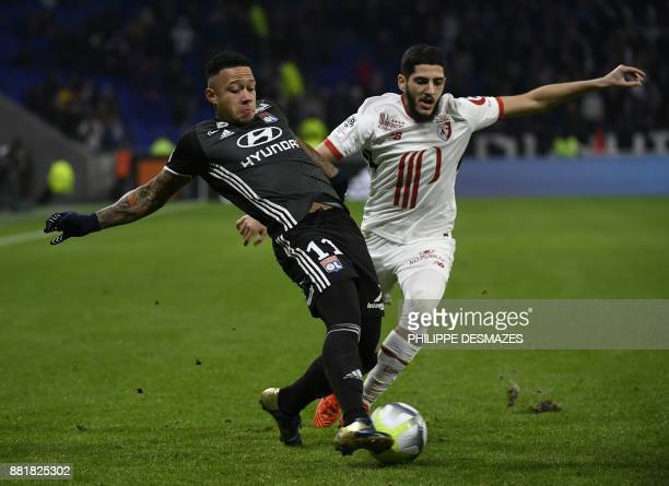 Lyon's Dutch forward Memphis Depay vies with Lille's French midfielder Yassine Benzia during the French L1 football match between Olympique Lyonnais...