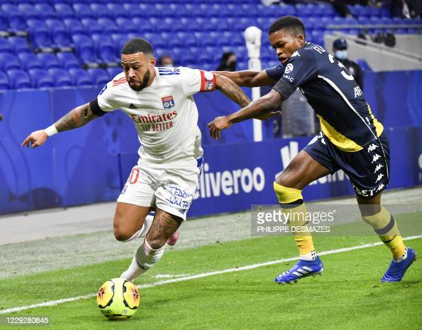 Lyon's Dutch forward Memphis Depay vies with Monaco's Portuguese midfielder Florentino Luis during the French L1 football match between Olympique...