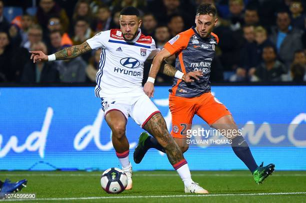 Lyon's Dutch forward Memphis Depay vies with Montpellier's French defender Ruben Aguilar during the French L1 football match between Montpellier and...