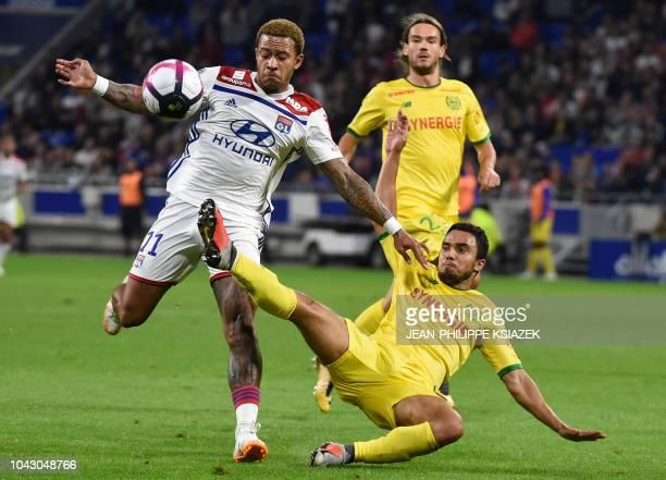 Lyon's Dutch forward Memphis Depay vies with Nantes' Brazilian defender Fabio Da Silva during the French L1 football match Lyon vs Nantes on...