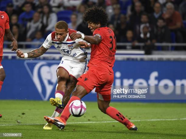 Lyon's Dutch forward Memphis Depay vies with Nice's Brazilian defender Dante during the French L1 football match between during the French L1...