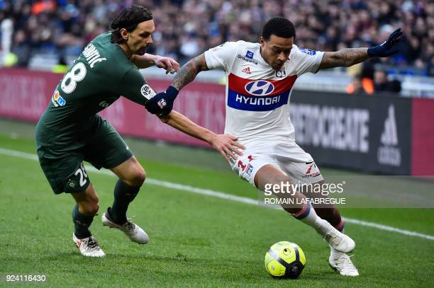 Lyon's Dutch forward Memphis Depay vies with SaintEtienne's Serbian defender Neven Subotic during the French L1 football match between Lyon and...