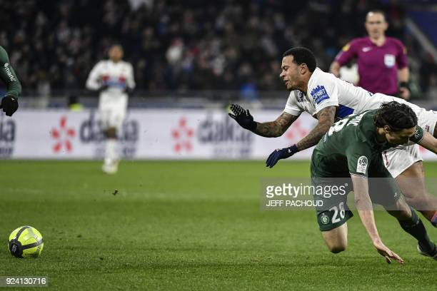 Lyon's Dutch forward Memphis Depay vies with SaintEtienne's Serbian defender Neven Subotic during the French L1 football match Olympique Lyonnais...