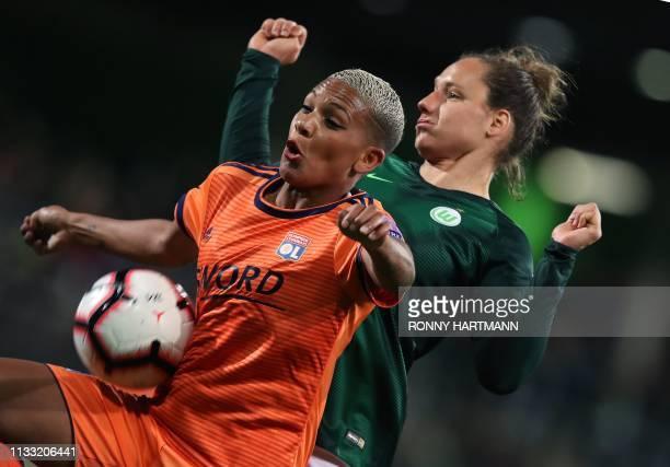 Lyon's Dutch forward Shanice van de Sanden vies with Wolfsburg's German defender Babett Peter during the UEFA women's Champions League quarterfinal...