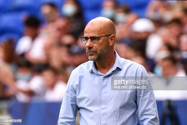 Lyon's Dutch head coach Peter Bosz looks on during the French L1 football match between Olympique Lyonnais and Clermont Foot 63 at the Groupama...