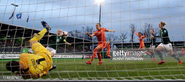 Lyon's English defender Lucy Bronze scores the opening goal during the UEFA women's Champions League quarterfinal secondleg football match between...