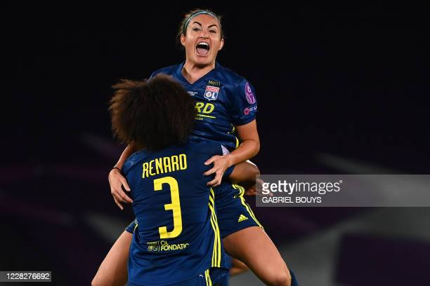 Lyon's English forward Jodie Taylor celebrates with Lyon's French defender Wendie Renard after winning the UEFA Women's Champions League final...
