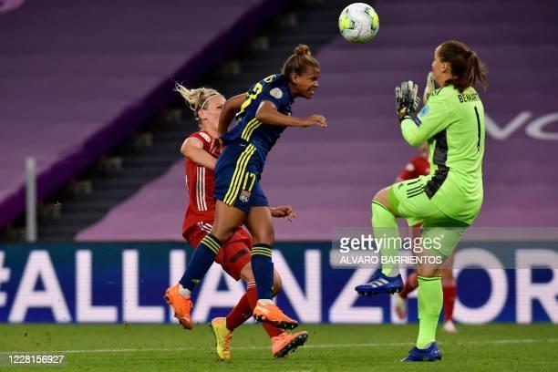 Lyon's English forward Nikita Parris scores a goal during the UEFA Women's Champions League quarter-final football match between Lyon and Bayern...