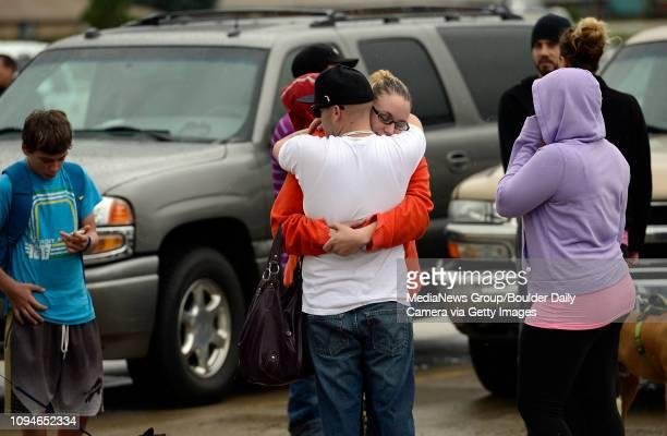Lyons evacuee Jessie Neueman gets a hug from Justin Abbott at LifeBridge Church Friday Sept 13 2013