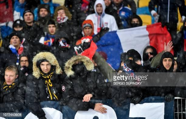 Lyon's fans attend the UEFA Champions League Groupe F football match FC Shakhtar Donetsk and Olympique Lyonnais on NSK Olimpiyskyi stadium in Kiev on...